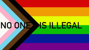 Raise the No One Is Illegal rainbow flag